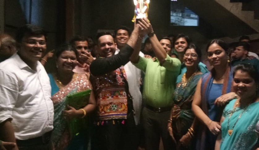 giving award to the winners of events held on the navratri